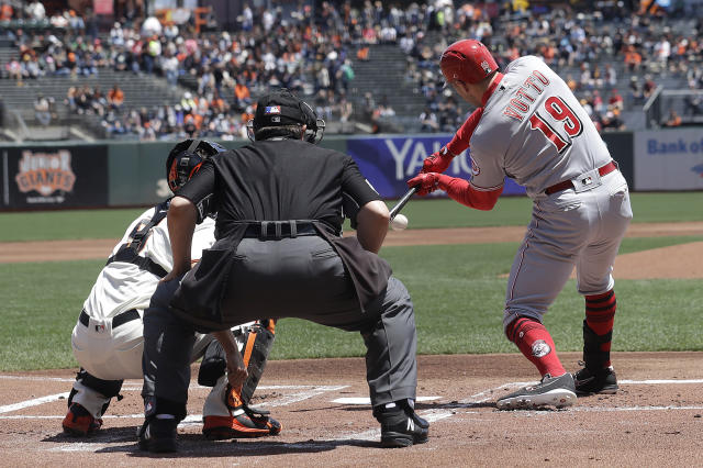 Cincinnati Reds' Joey Votto, right, hits an RBI-single against the San Francisco Giants during the first inning of a baseball game in San Francisco, Wednesday, May 16, 2018. (AP Photo/Jeff Chiu)