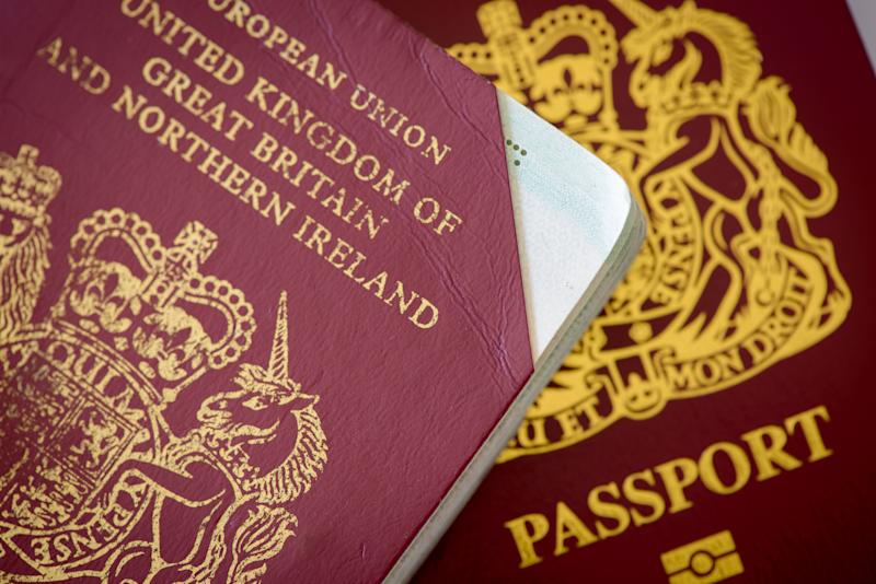 Antibes, France - September 29, 2018: New maroon UK passport, and invalidated UK passport with cut off top right corner.