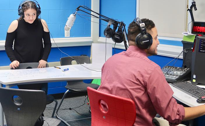 Mineola High School student Pamela Lopez records a podcast with the help of librarian Jeffrey Appelbaum.