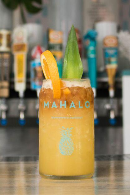 """<p><strong>Ingredients:</strong></p><p>1 oz Plantation 3 Stars Rum<br>1 oz Giffard Triple Sec<br>1 oz Demerara Syrup<br>1 oz Orange Juice<br>1 oz Pineapple Juice<br>.5 oz Lime Juice<br>1 oz Coruba Dark Rum</p><p><strong>Instructions:</strong></p><p>Fill 16 oz glass with crushed ice. Combine cubed ice, and all ingredients except for <a href=""""https://www.townandcountrymag.com/leisure/drinks/g9077403/best-sipping-rums/"""" rel=""""nofollow noopener"""" target=""""_blank"""" data-ylk=""""slk:dark rum"""" class=""""link rapid-noclick-resp"""">dark rum</a>. Shake for 8-10 seconds. Double strain into the prepared glass. Top glass off with dark rum. Place orange wheel on rim and garnish with pineapple leaf</p><p><em>From Mahalo in Chicago, IL.</em></p>"""
