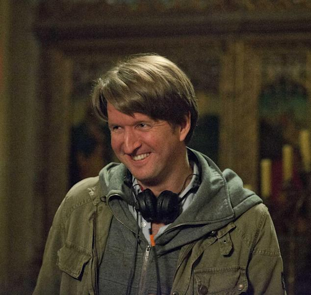 "This undated publicity photo provided by Universal Pictures shows Oscar®-winning director, Tom Hooper, on the set of his new film, ""Les Misérables,"" the motion-picture adaptation of the beloved global stage musical adapted from Victor Hugo's novel. (AP Photo/Universal Pictures/Laurie Sparham)"