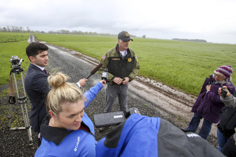 Linn County Sheriff's Bruce Riley briefs media during the investigate of a plane that crashed in a field north of Harrisburg, Ore., that left four people dead, Friday, April 7, 2017. (Collin Andrew/The Register-Guard via AP)