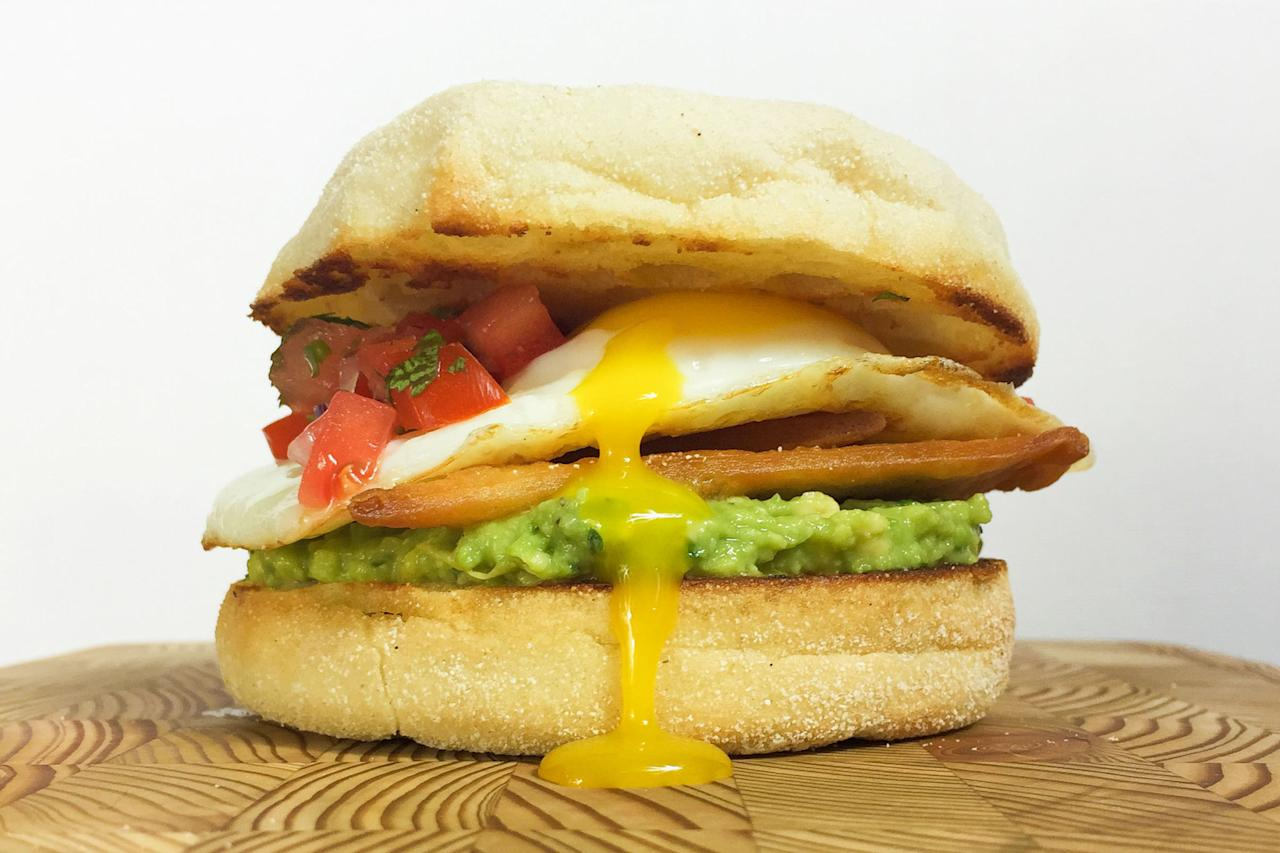 "<p>One word: guac.</p><p>Get the recipe from <a rel=""nofollow"" href=""http://www.delish.com/cooking/recipe-ideas/recipes/a43922/huevos-rancheros-breakfast-sandwich-recipe/"">Delish</a>.</p>"