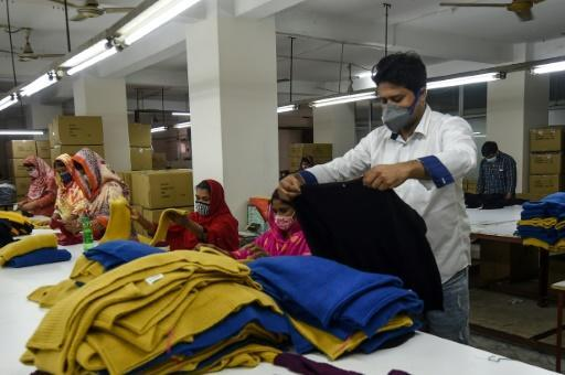Rubel Ahmed had to take out a swathe of loans to keep his staff on at his Bangladeshi garment firm -- the sector accounts for some 84 percent of the country's exports