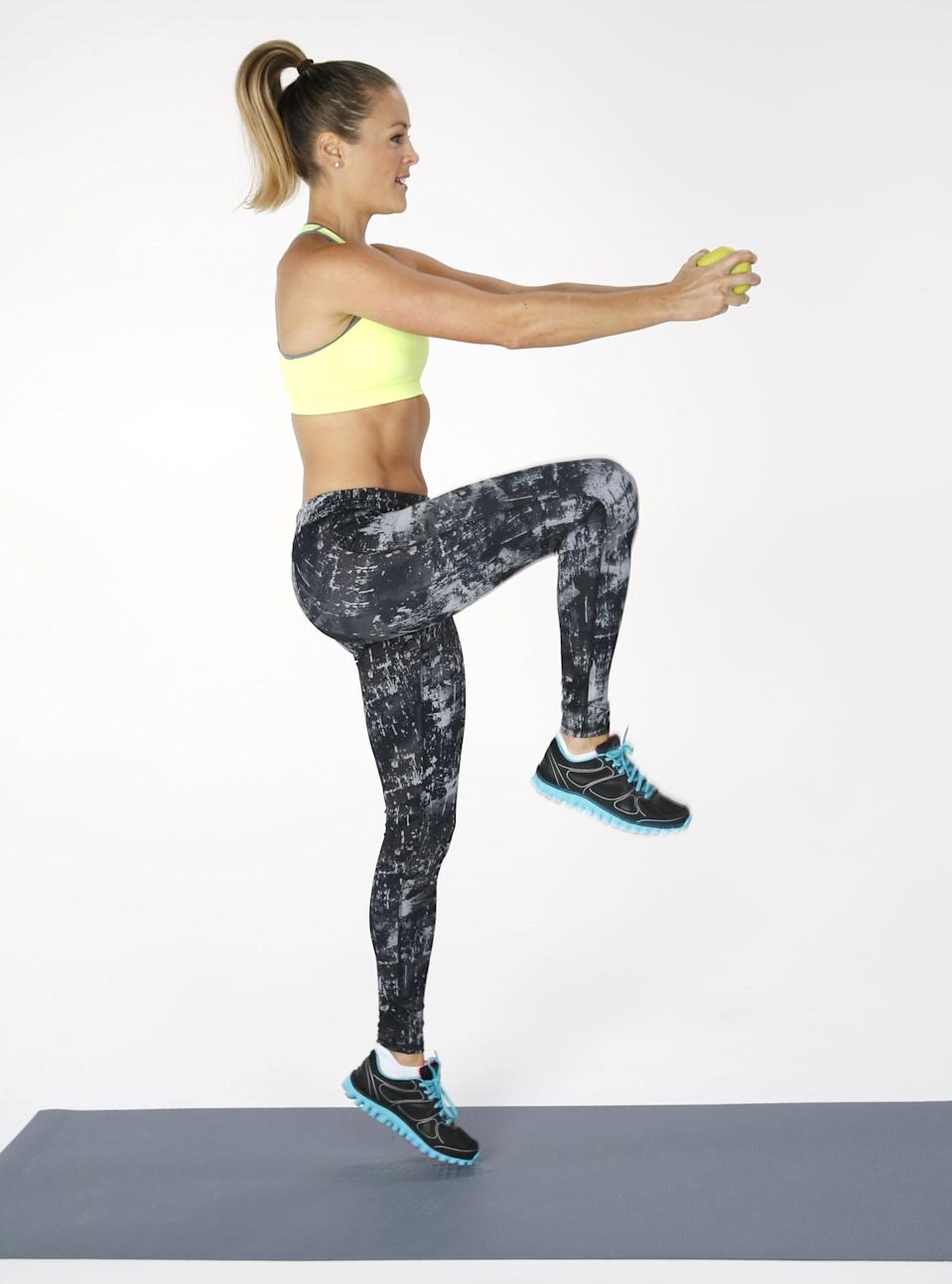 <ul> <li>Hold one dumbbell at chest height, and run in place while lifting your knees high to the level of your waist.</li> <li>Engage your abs as the knee comes up, continuing to run in place.</li> </ul>