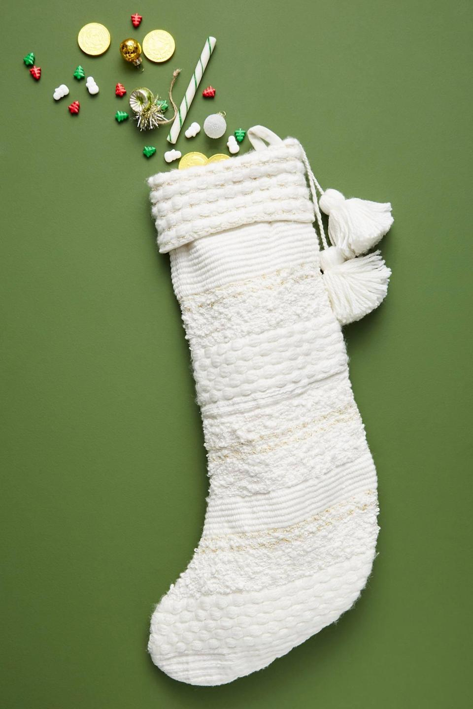 """<p>The <a href=""""https://www.popsugar.com/buy/Nicholas-Knit-Stocking-490446?p_name=Nicholas%20Knit%20Stocking&retailer=anthropologie.com&pid=490446&price=38&evar1=casa%3Aus&evar9=46615300&evar98=https%3A%2F%2Fwww.popsugar.com%2Fhome%2Fphoto-gallery%2F46615300%2Fimage%2F46615316%2FNicholas-Knit-Stocking&list1=shopping%2Canthropologie%2Choliday%2Cchristmas%2Cchristmas%20decorations%2Choliday%20decor%2Chome%20shopping&prop13=mobile&pdata=1"""" rel=""""nofollow noopener"""" class=""""link rapid-noclick-resp"""" target=""""_blank"""" data-ylk=""""slk:Nicholas Knit Stocking"""">Nicholas Knit Stocking</a> ($38) is simple yet elegant. </p>"""