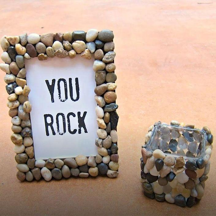 """<p>Dad totally rocks, and to show him that, you can hot glue small stones and pebbles from the yard to a picture frame so he gets the message. </p><p><em>Get the tutorial at <a href=""""https://www.morenascorner.com/2014/06/diy-rocky-picture-frame.html"""" rel=""""nofollow noopener"""" target=""""_blank"""" data-ylk=""""slk:Morena's Corner"""" class=""""link rapid-noclick-resp"""">Morena's Corner</a>.</em></p>"""