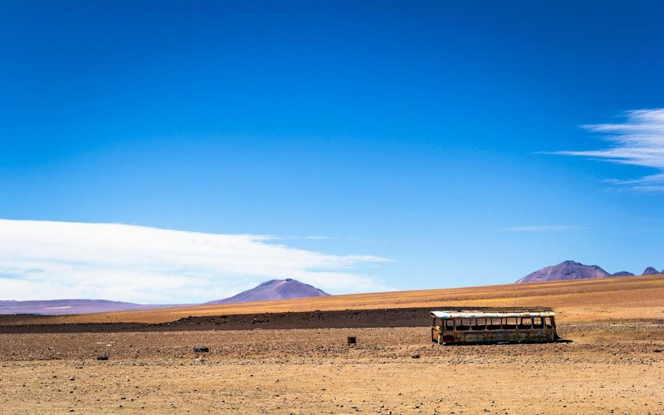 An abandoned bus at the border of Bolivia and Chile - Getty