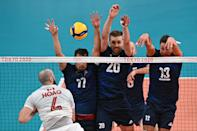 <p>(L-R) Canada's Nicholas Hoag hits the ball in front of Poland's Fabian Drzyzga, Mateusz Bieniek and Michal Kubiak in the men's preliminary round pool A volleyball match between Poland and Canada during the Tokyo 2020 Olympic Games at Ariake Arena in Tokyo on August 1, 2021. (Photo by Anne-Christine POUJOULAT / AFP)</p>