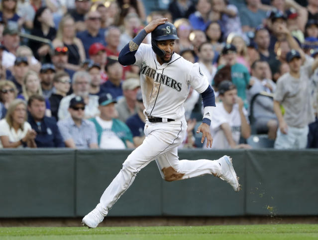 Seattle Mariners' J.P. Crawford heads home to score against the Los Angeles Angels in the third inning of a baseball game Saturday, July 20, 2019, in Seattle. (AP Photo/Elaine Thompson)