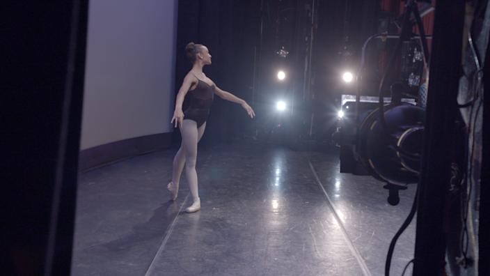 """A young dancer onstage at the School of American Ballet in Disney+'s """"On Pointe."""""""
