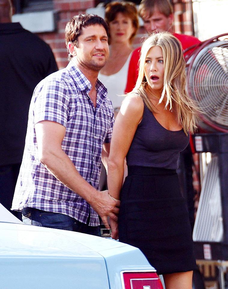 "The latest twist in the never-ending romance rumors about Jennifer Aniston and Gerard Butler, reports ShowbizSpy, is that ""Jen and Gerard did more than just celebrate"" her birthday in Mexico. A so-called Aniston source claims the ""Friends"" star has been telling pals they have ""amazing sex."" But that same article also floats that the two are faking a relationship to publicize their film, ""The Bounty Hunter."" Wait, so even though they're faking it, the sex is still ""amazing""? Read how <a href=""http://www.gossipcop.com/jennifer-aniston-sex-with-gerard-butler-as-fictional-as-it-is-amazing/"" target=""new"">Gossip Cop</a> separates what's fact and what's fake here. Brian Ach/<a href=""http://www.wireimage.com"" target=""new"">WireImage.com</a> - August 24, 2009"