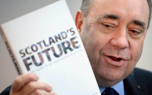 Alex Salmond with the Scottish Government's independence White Paper - Jeff J Mitchell