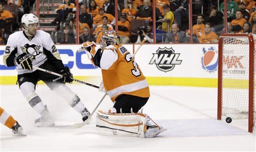 Pittsburgh Penguins' Eric Tangradi, left, watches a goal by teammate Jordan Staal against Philadelphia Flyers' Sergei Bobrovsky, right, of Russia, in the second period of Game 4 in a first-round NHL Stanley Cup playoffs hockey series on Wednesday, April 18, 2012, in Philadelphia. (AP Photo/Matt Slocum)