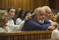 Barry Steenkamp, father of Reeva Steenkamp, is consoled by his wife June Steenkamp during the sentencing hearing of Olympic and Paralympic track star Oscar Pistorius at the North Gauteng High Court in Pretoria October 15, 2014. The 27-year-old Pistorius, whose lower legs were amputated as a baby, was convicted of culpable homicide last month for the shooting of 29-year-old law graduate and model Reeva Steenkamp on Valentine's Day 2013. REUTERS/Antoine de Ras/Pool (SOUTH AFRICA - Tags: SPORT ATHLETICS CRIME LAW)
