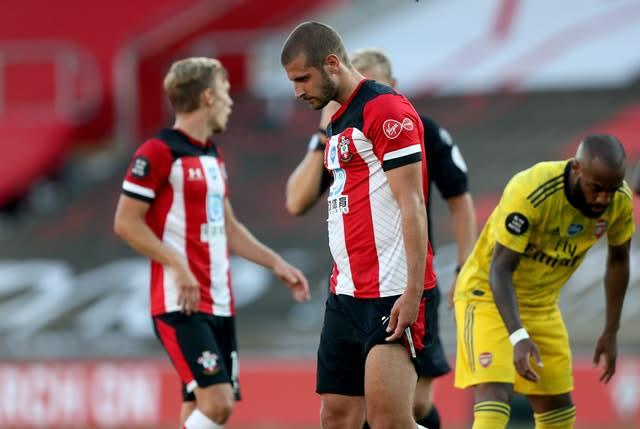 Jack Stephens walks off after being shown a red card (Andrew Matthews/NMC Pool/PA)