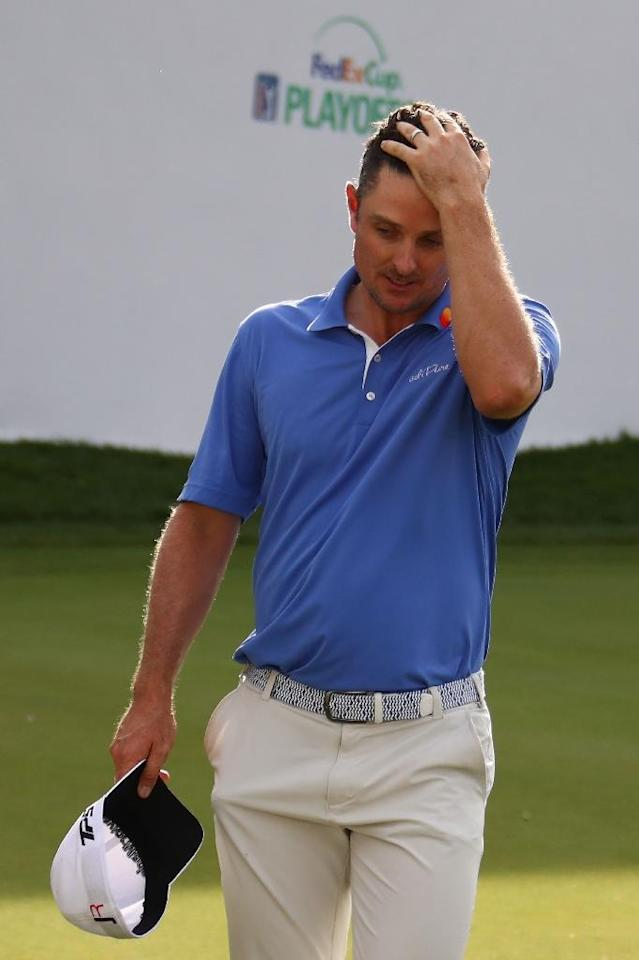 Justin Rose of England reacts to making a bogey on the 17th green during the final round of the BMW Championship, at Conway Farms Golf Club in Lake Forest, Illinois, on September 17, 2017 (AFP Photo/Gregory Shamus)