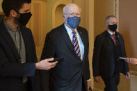 Sen. Patrick Leahy, D-Vt., walks with reporters, Tuesday, Jan. 26, 2021, as he leaves the Senate floor on Capitol Hill in Washington. (AP Photo/Jacquelyn Martin)