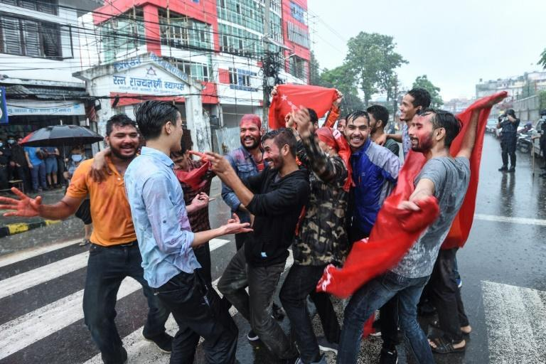 Protesters from various student wings celebrate after Nepal's Supreme Court ousted the sitting prime minister and reinstated the dissolved parliament, in Kathmandu on July 12, 2021