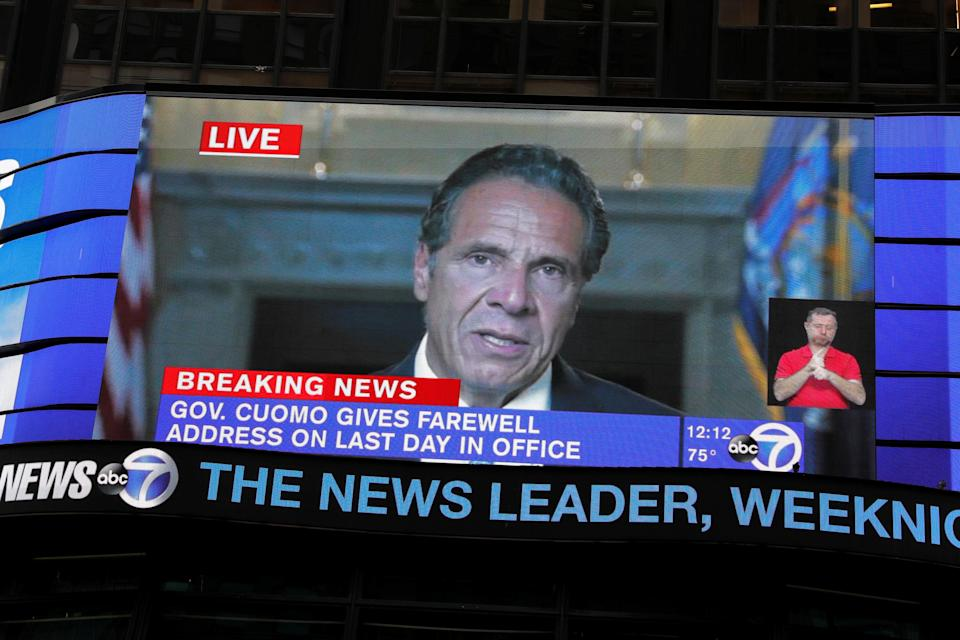 A screen in New York's Times Square shows Andrew Cuomo's farewell speech (REUTERS)