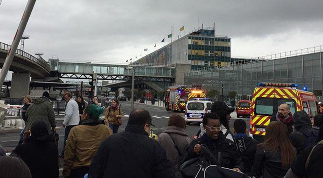 Photo shows passengers standing outside Paris' Orly Airport after a reported shooting. Source: Instageam/@afnay