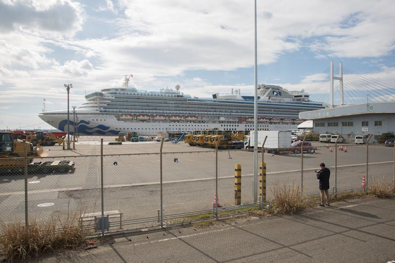 A man takes photos of a Diamond Princess cruise ship at Daikoku Pier in Yokohama. Around 3,600 people are quarantined on board due to fear of spreading the COVID-19 Corona virus, the authorities said, that there has been 39 new infections. (Photo by Stanislav Kogiku / SOPA Images/Sipa USA)