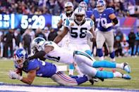 Dec 20, 2015; East Rutherford, NJ, USA; New York Giants running back Shane Vereen (34) runs for a touchdown against Carolina Panthers safety Roman Harper (41) during the fourth quarter at MetLife Stadium. Mandatory Credit: Brad Penner-USA TODAY Sports