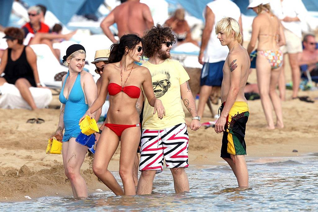 "Like father, like son! The doodles on Jack Osbourne's knees match the one on his dad. Forget about that, though ... who's the mystery girl in the red bikini? A new girlfriend for Jack, perhaps? <a href=""http://www. PacificCoastNews.com"" target=""new"">PacificCoastNews.com</a> - January 4, 2010"
