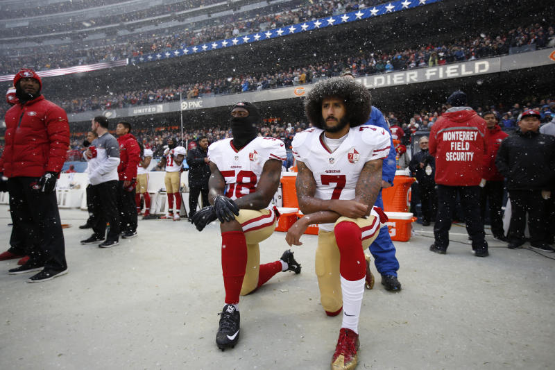 CHICAGO, IL - DECEMBER 4: Eli Harold #58 and Colin Kaepernick #7 of the San Francisco 49ers kneel on the sideline, during the anthem, prior to the game against the Chicago Bears at Soldier Field on December 4, 2016 in Chicago, Illinois. The Bears defeated the 49ers 26-6. (Photo by Michael Zagaris/San Francisco 49ers/Getty Images)