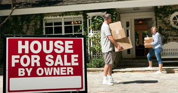 Couple moving into new home | Image Source/Getty Images