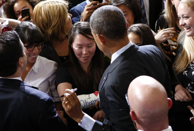 """U.S. President Barack Obama signs the cast of Cathey Park of Cambridge, Massachusetts after he spoke about health insurance at Faneuil Hall in Boston October 30, 2013. The cast for her broken wrist reads, """"I Love Obamacare."""" REUTERS/Kevin Lamarque (UNITED STATES - Tags: POLITICS HEALTH)"""