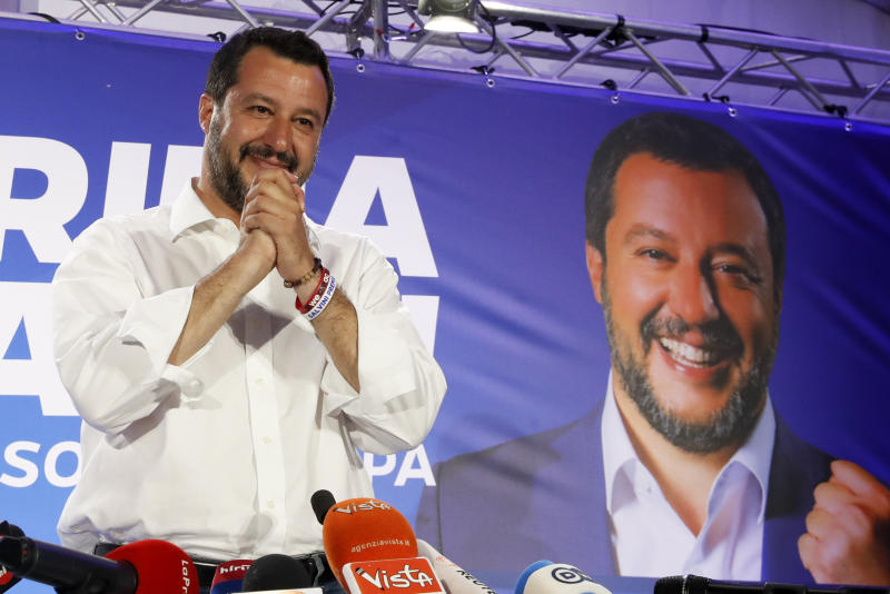 Italian Interior Minister and Deputy Premier Matteo Salvini arrives to meet reporters for a press conference at the League headquarters in Milan, Italy, early Monday morning, May 27, 2019. Italian Interior Minister and Deputy Premier Matteo Salvini, of the League kisses a crucifix as as he talks to reporters during a press conference at the League headquarters in Milan, Italy, early Monday morning, May 27, 2019. Italy's anti-migrant, anti-Islam interior minister, Matteo Salvini, boosted his right-wing League party to become the No. 1 party in Italy, with more than 30 percent of the vote, according to early projections. (AP Photo/Antonio Calanni)