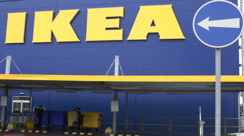 People walk alongside an IKEA outlet in Prague, February 25, 2013.  Swedish furniture giant IKEA said on Monday it has stopped selling meatballs from a specific batch which has tested positive for traces of horsemeat by Czech authorities. REUTERS/Petr Josek (CZECH REPUBLIC - Tags: BUSINESS FOOD POLITICS)