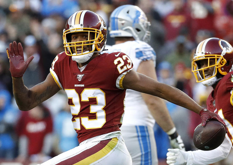 FILE - In this Nov. 24, 2019, file photo, then Washington Redskins cornerback Quinton Dunbar (23) reacts after intercepting a pass from Detroit Lions quarterback Jeff Driskel during the second half of an NFL football game in Landover, Md. Police in South Florida are trying to find New York Giants cornerback DeAndre Baker and Seattle Seahawks cornerback Dunbar after multiple witnesses accused them of an armed robbery at a party. Miramar police issued arrest warrants for both men Thursday, May 14, 2020. (AP Photo/Patrick Semansky, File)