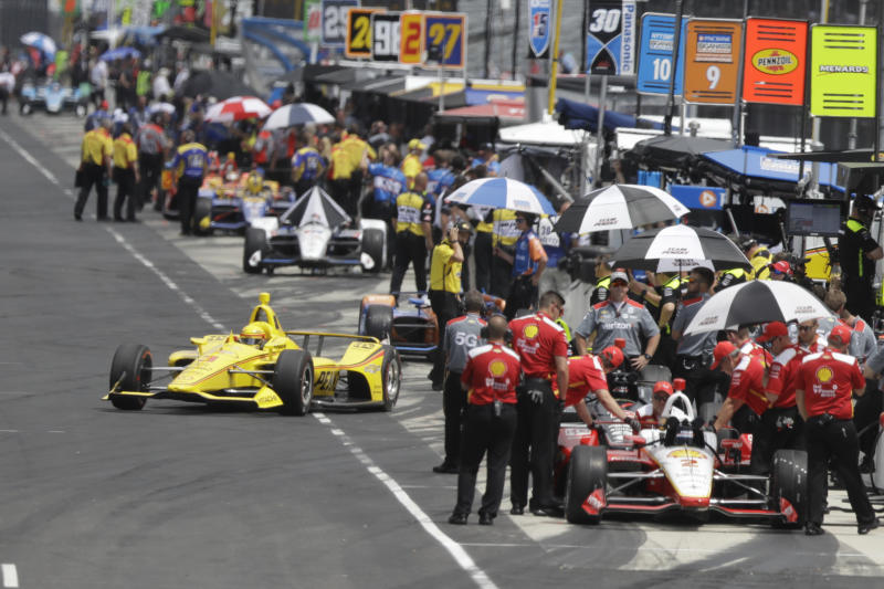 Helio Castroneves, of Brazil, pulls out of the pits during practice for the Indianapolis 500 IndyCar auto race at Indianapolis Motor Speedway, Friday, May 17, 2019 in Indianapolis. (AP Photo/Darron Cummings)
