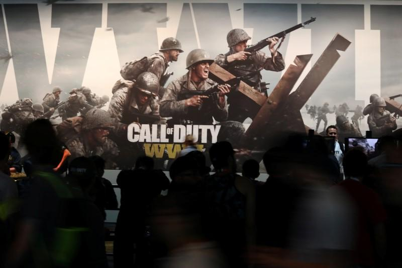 "Attendees walk past a ""Call of Duty"" advertisement at the E3 2017 Electronic Entertainment Expo in Los Angeles"