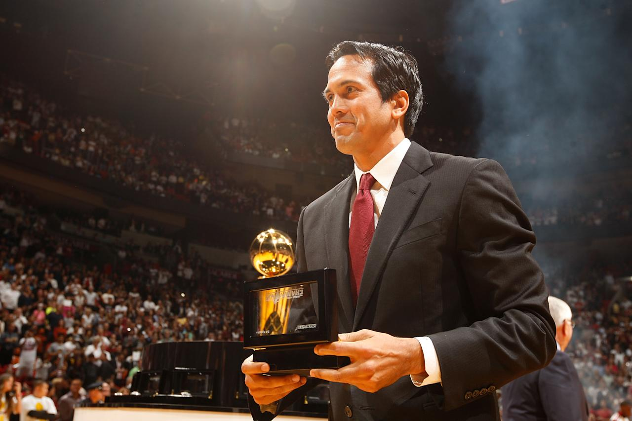 MIAMI, FL - OCTOBER 30: Head Coach Eric Spoelstra of the Miami Heat holds his 2012 NBA Championship ring during a ceremony prior to the NBA game against the Boston Celtics on October 30, 2012 at American Airlines Arena in Miami, Florida. NOTE TO USER: User expressly acknowledges and agrees that, by downloading and/or using this photograph, user is consenting to the terms and conditions of the Getty Images License Agreement. Mandatory copyright notice: Copyright NBAE 2012 (Photo by Issac Baldizon/NBAE via Getty Images)