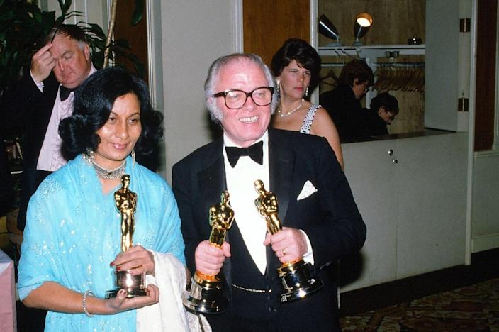"""LOS ANGELES,CA - APRIL 11, 1983: Director Richard Attenborough winner of """"Best Director"""" poses with Bhanu Athaiya winner of """"Best Costume Design"""" backstage during the 55th Academy Awards at Dorothy Chandler Pavilion, Los Angeles, California. (Photo by Michael Montfort/Michael Ochs Archives/Getty Images)"""