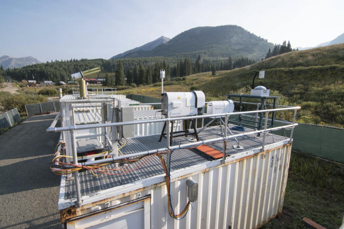 This Aug. 17, 2021 photo provided by Lawrence Berkeley National Laboratory shows Atmospheric Radiation Measurement instruments that will collect data from September to June 2023 during the Surface Atmosphere Integrated Field Laboratory (SAIL) campaign in Gothic, Colorado. The SAIL campaign will provide insights into mountainous water-cycle processes. Federal scientists are launching an effort to better understand the hydrology in the U.S. West. The U.S. Department of Energy on Tuesday, Aug. 24 announced a new kind of climate observatory near the headwaters of the Colorado River. (David Chu/Lawrence Berkeley National Laboratory via AP)