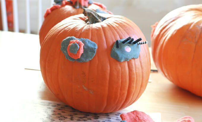 """<p>Pumpkin decorating doesn't have to be just mom or dad's job, especially when no carving is involved. Using Play-Doh, this family project lets your kids bring their best creations to life—because sentimental gourds always rival even the most pristine painted pumpkins. </p><p><strong>Get the tutorial at <a href=""""https://artfulparent.com/easy-pumpkin-faces-playdough/"""" rel=""""nofollow noopener"""" target=""""_blank"""" data-ylk=""""slk:The Artful Parent"""" class=""""link rapid-noclick-resp"""">The Artful Parent</a>. </strong> </p>"""