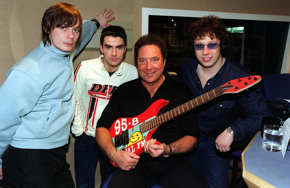 Welsh music stars, pop legend Tom Jones, (centre right), with members of the band Stereophonics, (l/r) Richard Jones, Kelly Jones, and Stuart Cable, after pre-recording a show at the Capital FM studios, Leicester Square, London.