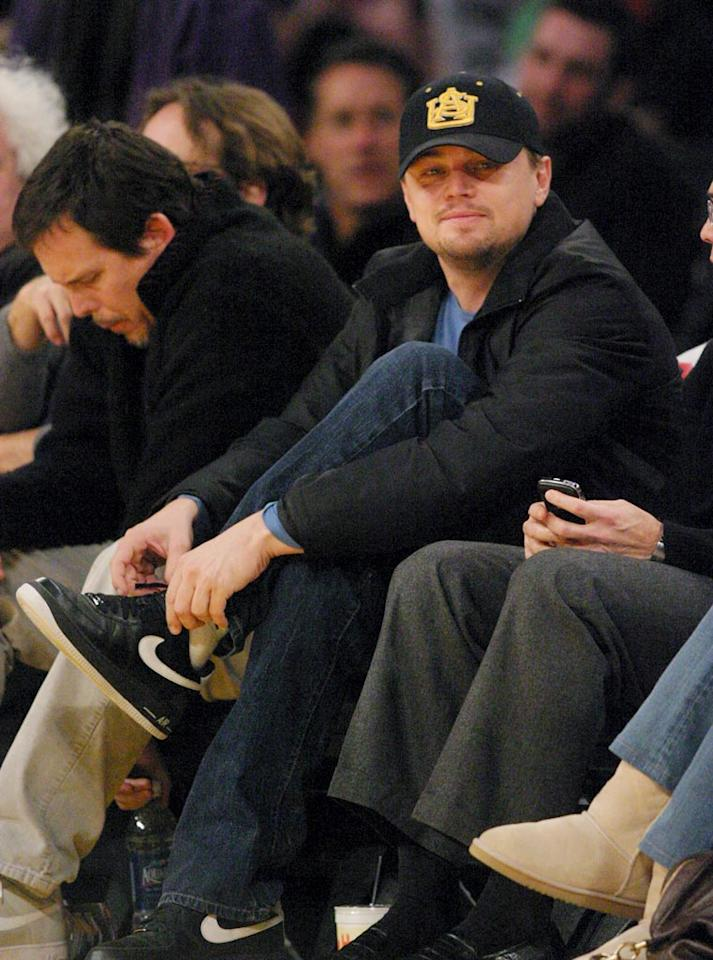 """The delicious Leonardo DiCaprio also enjoys the game from the comfort of the front row. Kevin Reece/London Ent/<a href=""""http://www.splashnewsonline.com"""" target=""""new"""">Splash News</a> - December 16, 2008"""