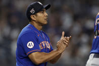 New York Mets manager Luis Rojas walks to the mound for a pitching change during the fifth inning of the second baseball game of a doubleheader against the New York Yankees, Sunday, July 4, 2021, in New York. (AP Photo/Adam Hunger)