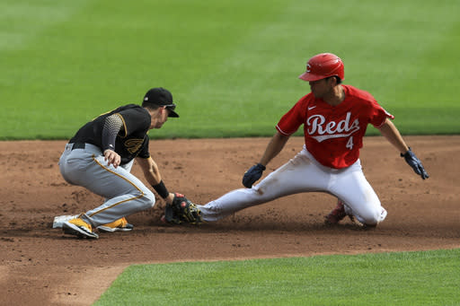 Pittsburgh Pirates' Kevin Newman, left, tags out Cincinnati Reds' Shogo Akiyama, right, who was attempting to steal second base in the first inning during a baseball game in Cincinnati, Monday, Sept. 14, 2020. (AP Photo/Aaron Doster)