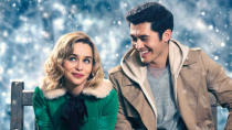 """The internet told everybody the twist on the day the trailer came out, but Paul Feig's Wham-inflected romcom still soared at the box office thanks to the undeniable charm of Emilia Clarke and Henry Golding. <a href=""""https://uk.movies.yahoo.com/last-christmas-paul-feig-critics-box-office-155204550.html"""" data-ylk=""""slk:Critical raspberries were duly ignored;outcm:mb_qualified_link;_E:mb_qualified_link;ct:story;"""" class=""""link rapid-noclick-resp yahoo-link"""">Critical raspberries were duly ignored</a>. (Credit: Universal)"""