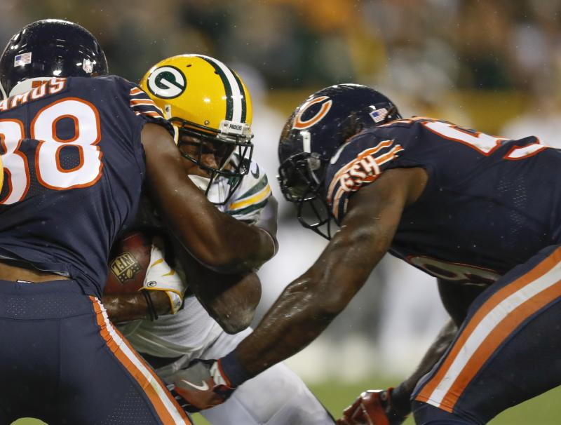 The hit that Danny Trevathan (R) delivered to Davante Adams knocked out the Packer from the game. (AP)