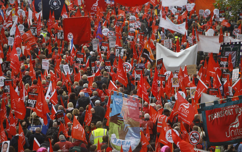 """Demonstrators take part in an anti-austerity protest march entitled """"a future that works"""" through central London, Saturday, Oct. 20, 2012.  The march Saturday was organized by Britain's TUC (Trades Union Congress) and was attended by various trade unions, community groups and individuals. (AP Photo/Alastair Grant)"""