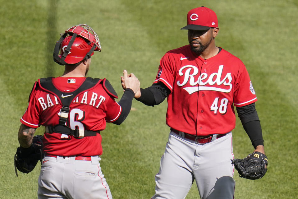 Cincinnati Reds relief pitcher Mychal Givens (48) celebrates with catcher Tucker Barnhart after getting the final out of a baseball game against the Pittsburgh Pirates in Pittsburgh, Thursday, Sept. 16, 2021. The Reds won 1-0. (AP Photo/Gene J. Puskar)