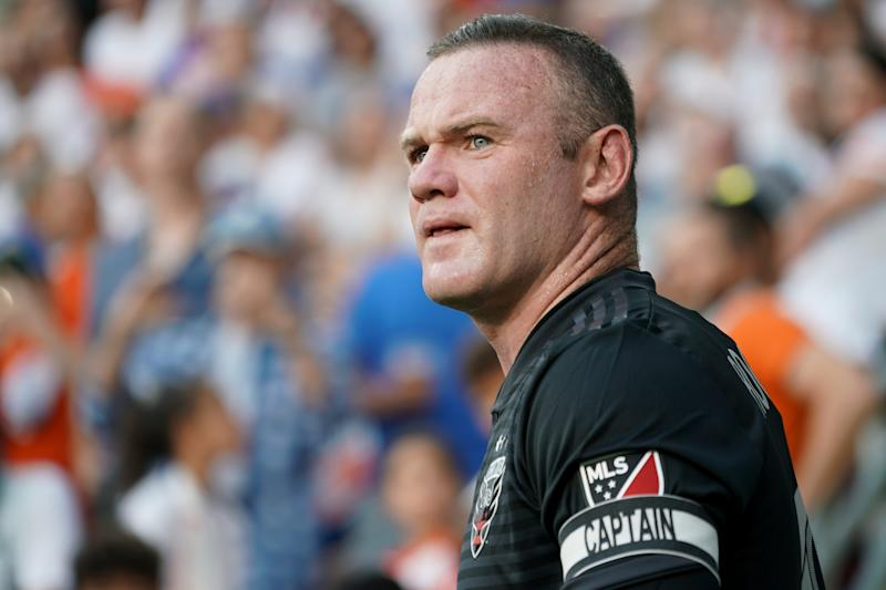 Jul 18, 2019; Cincinnati, OH, USA; D.C. United forward Wayne Rooney (9) waits to play the ball against FC Cincinnati in the first half at Nippert Stadium. Mandatory Credit: Aaron Doster-USA TODAY Sports