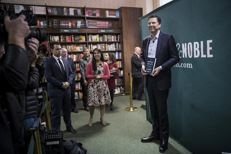 """A Higher Loyalty"" by former FBI chief James Comey, seen here giving a talk in a New York bookstore, has also tapped into Americans' fascination with the Trump presidency (AFP Photo/Drew Angerer)"